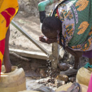 Happy people are now able to collect sparkling, clear water for their families to drink at the Montana on a Mission Oiti borehole.