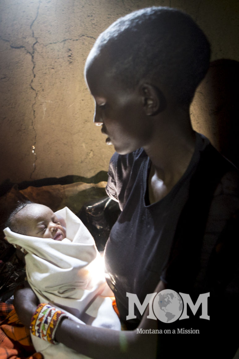 A mother and her newborn baby. This woman gave birth at the spring during a water development project in the Ripoi area.