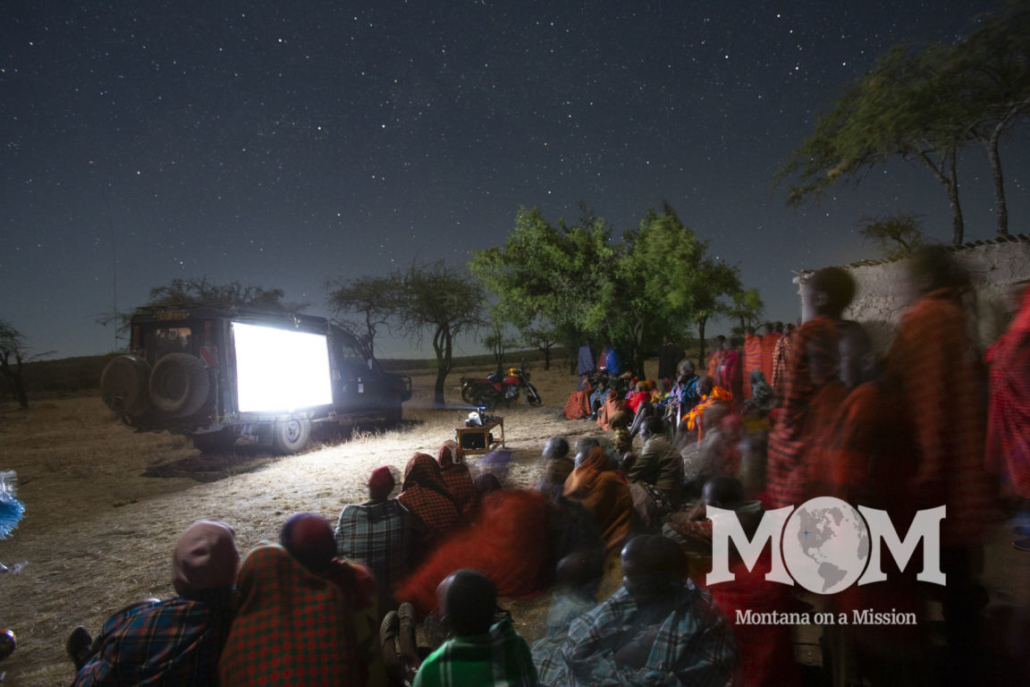 """Maasai families gather to watch the story of Jesus in their own language for the first time. Montana on a mIssion partners with Life Ministries to share the word of God through the """"Jesus"""" film and """"Magdelena"""""""