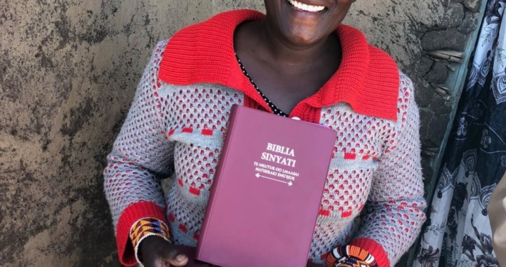 Sharing the Word! Besides drilling for clean water during our June visit to Kenya, we were able to show the Jesus film and give out 200 more Maasai language Bibles. These photos are of three rural pastors receiving Bibles to share with their congregations.